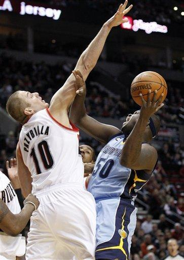 Portland Trail Blazers' Joel Przybilla (10) guards Memphis Grizzlies' Zach Randolph (50) during the first quarter of an NBA basketball game Thursday, March 22, 2012, in Portland, Ore. (AP Photo/Rick Bowmer)