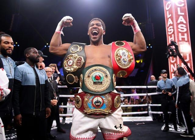 Anthony Joshua holds the WBA, IBF and WBO titles in boxing's blue riband division (Nick Potts/PA)