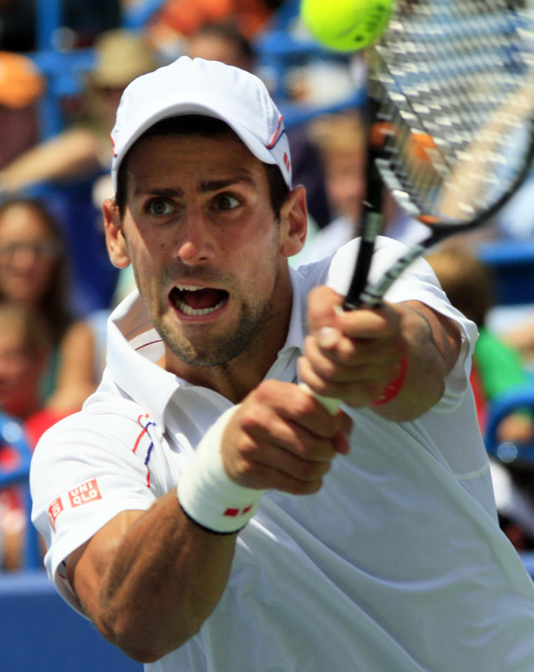 Novak Djokovic, from Serbia, hits a backhand shot against Marin Cilic, from Croatia, during a quarterfinals match at the Western & Southern Open tennis tournament, Friday, Aug. 17, 2012, in Mason, Ohio. Djokovic won 6-3, 6-2. (AP Photo/Al Behrman)