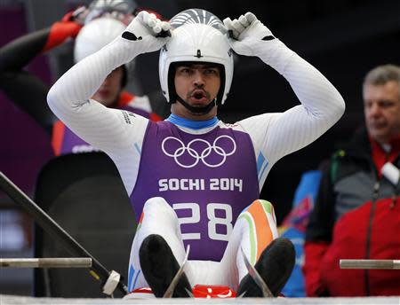 India's Keshavan prepares for the start during the men's luge training at the Sanki sliding center in Rosa Khutor, a venue for the Sochi 2014 Winter Olympics near Sochi