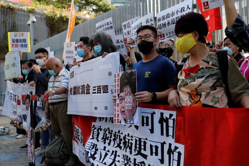 Protesters shout slogans before Hong Kong Financial Secretary Paul Chan delivers the annual budget, outside the Legislative Council in Hong Kong