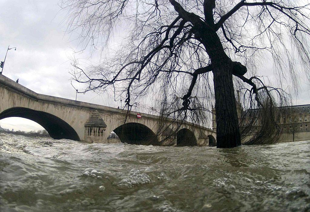 <p>The waters of the Seine River flow out of its banks near the Pont Royal bridge after days of rainy weather, in Paris, France.</p>