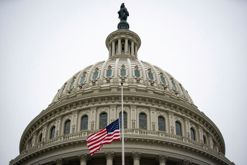 The American flag flies at half staff at the U.S. Capitol Building on the fifth day of the impeachment trial of former U.S. President Donald Trump