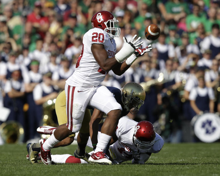 Oklahoma's Frank Shannon (20) intercepts a pass from Notre Dame's Tommy Rees during the first half of an NCAA college football game on Saturday, Sept. 28, 2013, in South Bend, Ind. (AP Photo/Darron Cummings)
