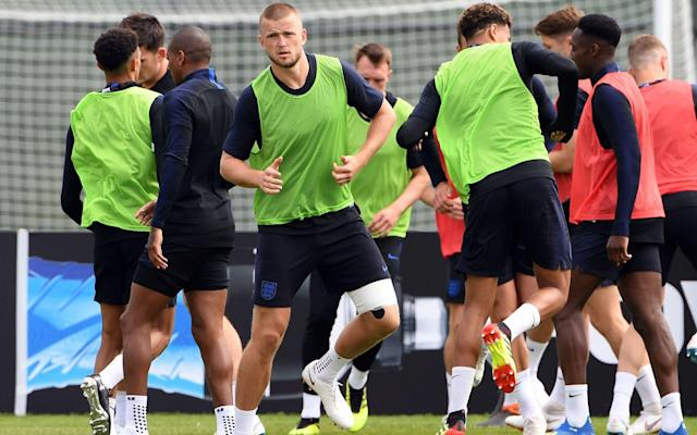 Eric Dier dismisses injury fears after wearing leg strapping during first England training session in Russia