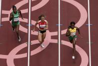 Shelly-Ann Fraser-Pryce, of Jamaica, Ajla Del Ponte, of Switzerland, and Nzubechi Nwokocha, of Nigeria, compete during the first round of the women's 100-meter the 2020 Summer Olympics, Friday, July 30, 2021, in Tokyo. (AP Photo/Morry Gash)