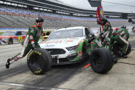 Kevin Harvick pits during the NASCAR Cup Series auto race at Texas Motor Speedway in Fort Worth, Texas, Wednesday, Oct. 28, 2020. (AP Photo/Richard W. Rodriguez)