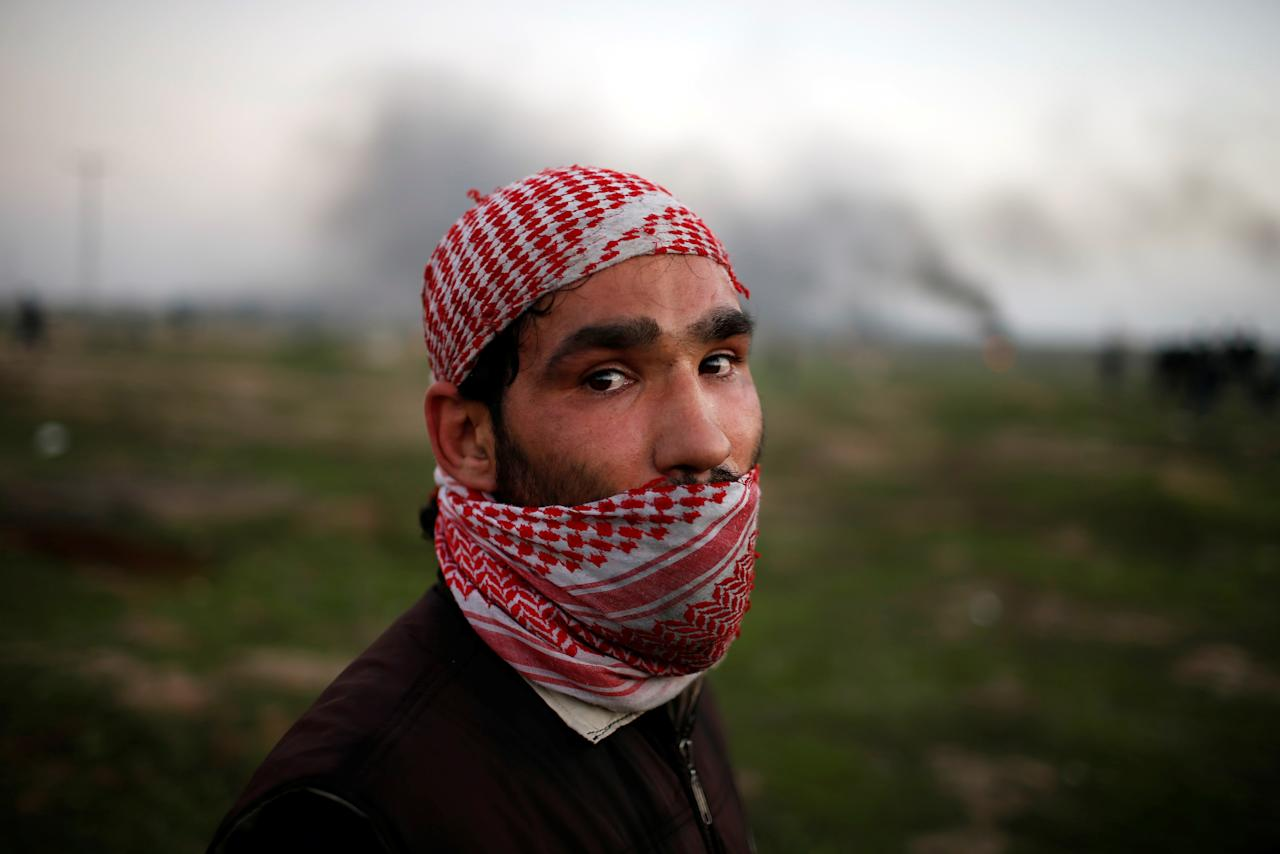 "<p>A Palestinian protester poses for a photograph at the scene of clashes with Israeli troops near the border with Israel, east of Gaza City, Jan. 12, 2018. ""As a young man, I feel very oppressed and deprived of a dignified life so the only thing I can do is to revolt against the thing behind this suffering – the Israeli occupation. The occupation seized our homeland with the support of America which now recognises Jerusalem as Israel's capital,"" he said. (Photo: Mohammed Salem/Reuters) </p>"