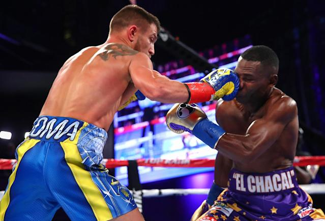 Vasyl Lomachenko (L) lands a jab on Guillermo Rigondeaux Saturday at Madison Square Garden in New York. (Mikey Williams/Top Rank)