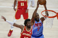 Brooklyn Nets forward Kevin Durant (7) shoots next to Atlanta Hawks' Solomon Hill during the first half of an NBA basketball game Wednesday, Jan. 27, 2021, in Atlanta. (AP Photo/Brynn Anderson)