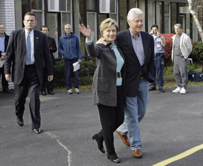 <p>Sen. Hillary Clinton waves to onlookers after voting in Chappaqua, N.Y., with her husband, former President Bill Clinton, on Nov. 7, 2006. (Photo: Stuart Ramson/AP)</p>