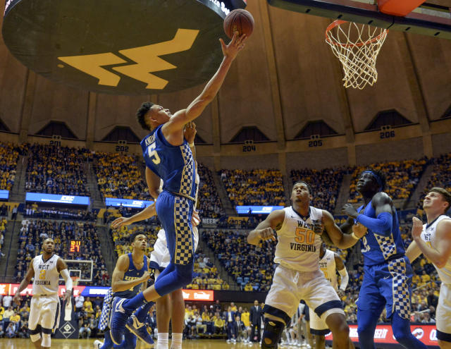 Kentucky forward Kevin Knox attempts a layup over West Virginia forward Sagaba Konate during the second half of an NCAA college basketball game Saturday, Jan. 27, 2018, in Morgantown, W.Va. (William Wotring/The Dominion-Post via AP)