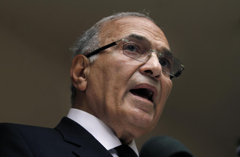 FILE - In this Saturday, May 26, 2012 file photo, Egyptian presidential candidate Ahmed Shafiq speaks to the media during a press conference at his office in Cairo, Egypt. Earlier this week, the military received criticism from deep within its establishment. Shafiq, the former head of the air force and the last prime minister under Mubarak who came in second in the 2012 elections, criticized the army's support of el-Sissi and said he would not run for president, according to a recording of a private conversation leaked on the Internet. (AP Photo/Khalil Hamra, File)