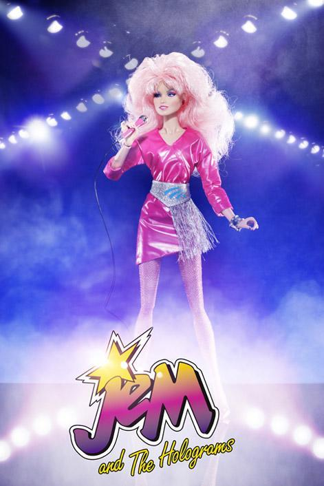 """<div class=""""caption-credit"""">Photo by: Hasbro/Integrity Toys</div><b>New Jem</b> <br> The new 12"""" doll is admittedly sexier than the original, but her outfit still looks """"truly outrageous."""" Her new hair is cotton candy pink (like it was in the original cartoon), but all clothing and accessories are on point. She does not have flashing earrings, but her removable JemStar earrings look just like the ones we saw on TV. She also has hand-applied eyelashes and gets a mic stand and an extra set of hands (creepy!) so you can pose her differently."""