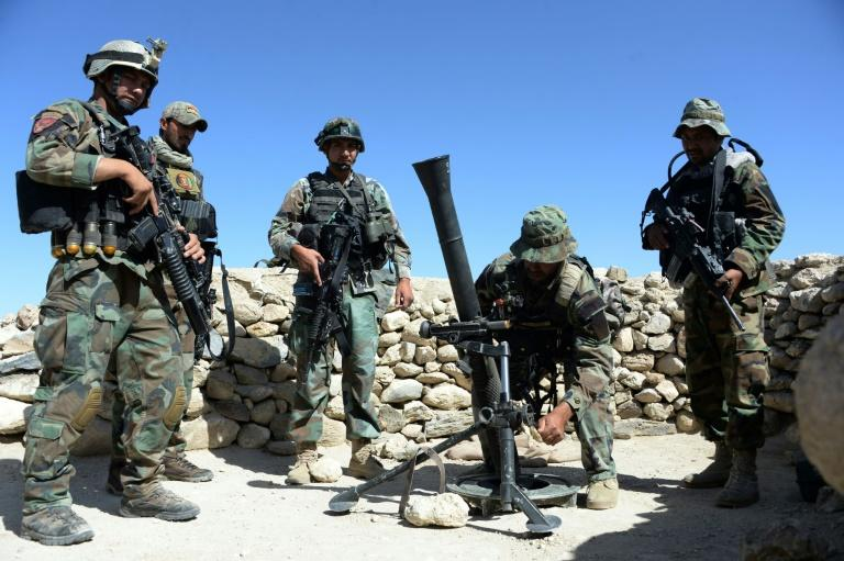Afghan commandos prepare to launch mortar shells on an Islamic State (IS) militant stronghold in Achin district of Nangarhar
