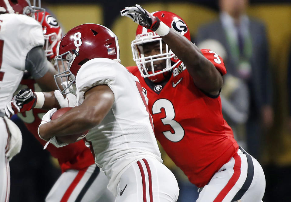 Linebacker Roquan Smith, the Bears' first-round pick, makes a tackle in the College Football Playoff title game. (AP)