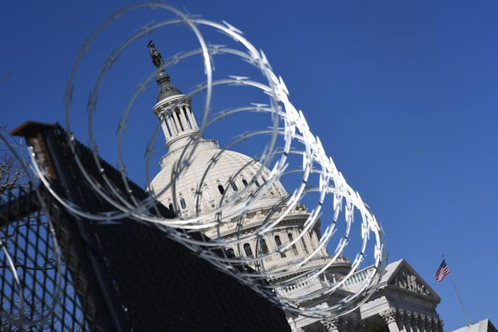 A barbed wire-topped fence has surrounded the Capitol since the insurrection in January. (AFP via Getty Images)
