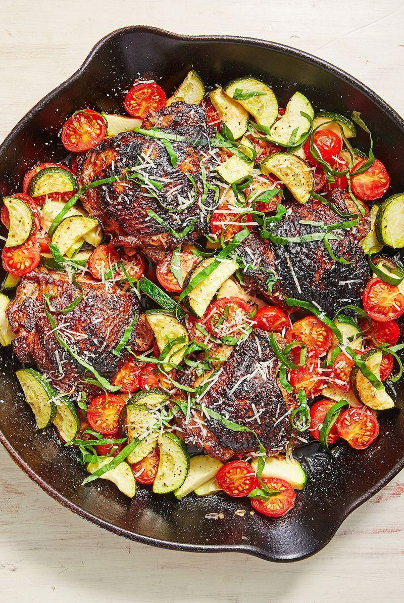 """<p>This is the perfect weeknight dinner. After marinating the chicken, everything — including the veggie side! — comes together in one pan in less than 30 minutes. Call it another <a href=""""https://www.delish.com/uk/chicken-recipes/"""" rel=""""nofollow noopener"""" target=""""_blank"""" data-ylk=""""slk:chicken dinner"""" class=""""link rapid-noclick-resp"""">chicken dinner</a> win! </p><p>Get the <a href=""""https://www.delish.com/uk/cooking/recipes/a29794011/balsamic-basil-chicken-recipe/"""" rel=""""nofollow noopener"""" target=""""_blank"""" data-ylk=""""slk:Balsamic Basil Chicken"""" class=""""link rapid-noclick-resp"""">Balsamic Basil Chicken</a> recipe.</p>"""