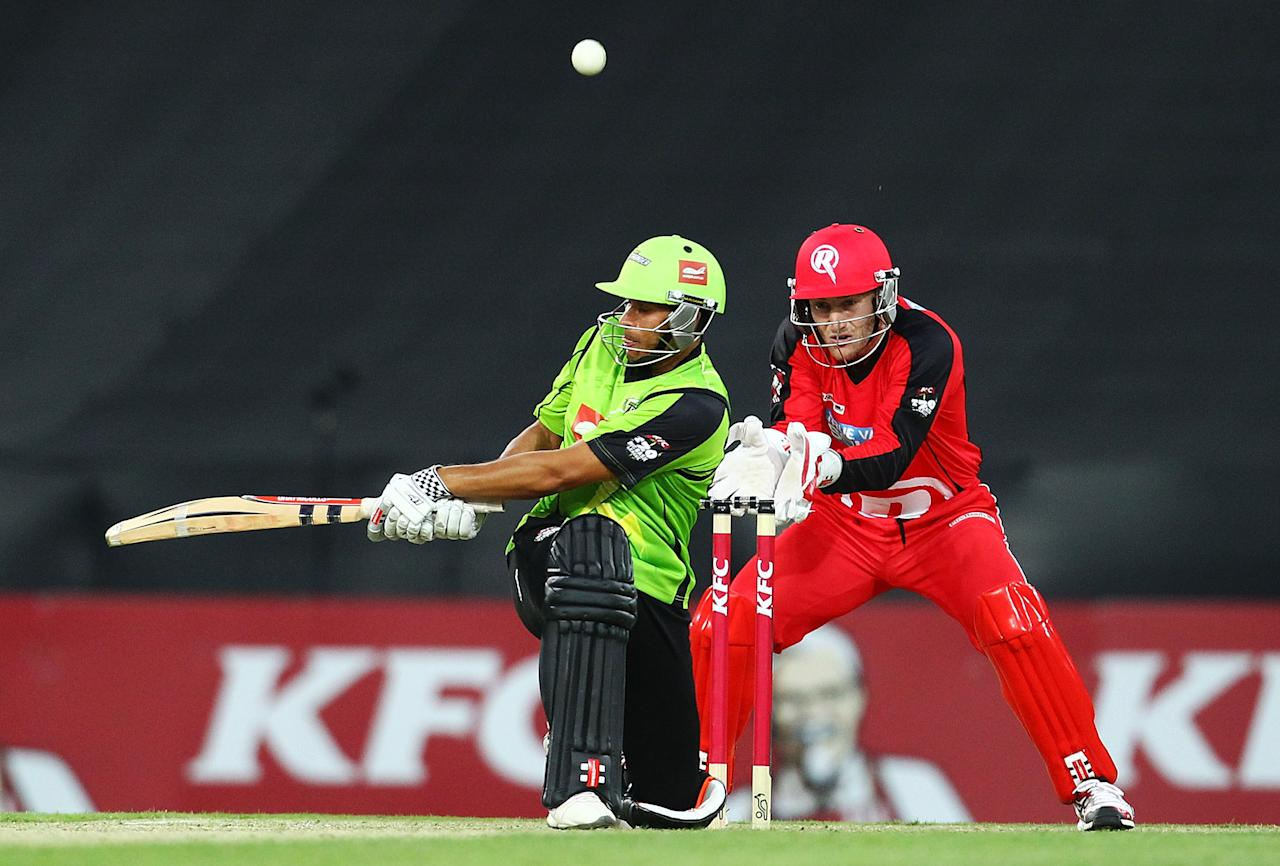 SYDNEY, AUSTRALIA - DECEMBER 14:  Usman Khawaja of the Thunder bats during the Big Bash League match between the Sydney Thunder and the Melbourne Renegades at ANZ Stadium on December 14, 2012 in Sydney, Australia.  (Photo by Mark Nolan/Getty Images)