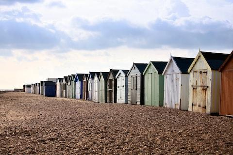 Colourful beach huts in Felixstowe - Credit: getty