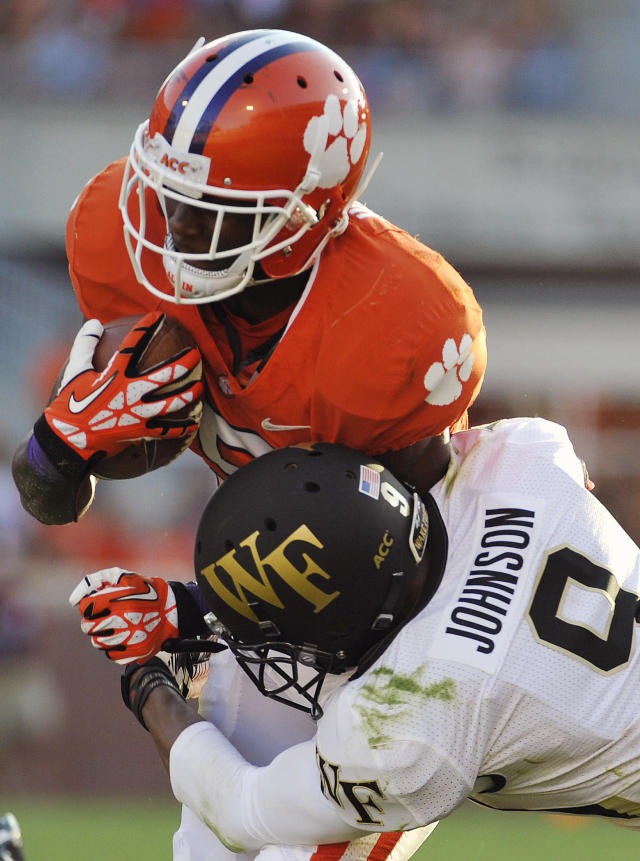 Clemson wide receiver Germone Hopper (5) is hit by Wake Forest cornerback Kevin Johnson (9) during the second half of an NCAA college football game, Saturday, Sept. 28, 2013, in Clemson, S.C. Clemson won 56-7. (AP Photo/Rainier Ehrhardt)