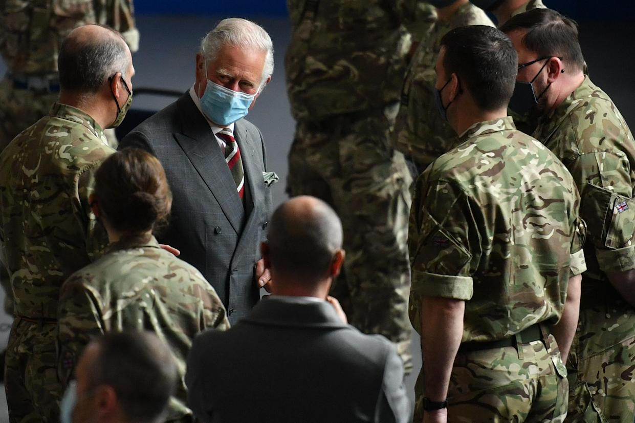 The Prince of Wales meets members of the RAF who helped during the mass testing for Covid-19 in South Wales, as part of his visit to the Engine House youth charity in Merthyr Tydfil, South Wales. Picture date: Friday May 14, 2021.