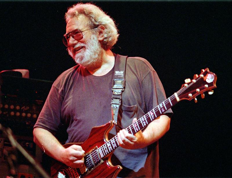 """FILE - This Nov. 1, 1992 file photo shows Grateful Dead lead singer Jerry Garcia performing in Oakland , Calif. The San Francisco Chronicle reports more than 1,100 people have signed an online petition opposing any name change to Jerry Garcia Amphitheater in Excelsior, near where the late guitarist grew up.  The proposed name is """"Levitt Pavilion San Francisco at Jerry Garcia Meadows."""" Critics say handing it over to Levitt would rob the venue of its independent spirit. The 2,000-seat theater hosts fewer than 10 events a year. (AP Photo/Kristy McDonald, file)"""