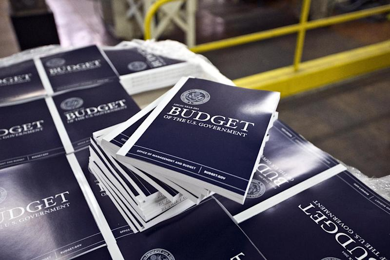 """In this April 8, 2013, photo, copies of President Barack Obama's budget plan for fiscal year 2014 are prepared for delivery at the U.S. Government Printing Office in Washington. Obama is sending Congress on Wednesday, April 10, his long-awaited budget, an effort to achieve an elusive """"grand bargain"""" to tame run-away deficits that have soared above $1 trillion for each of the past four years.  (AP Photo/J. Scott Applewhite)"""