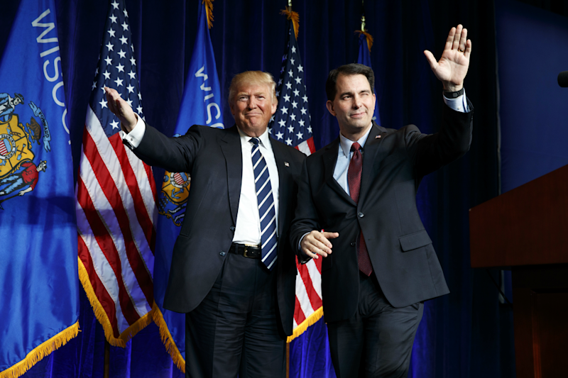 Scott Walker (right), the incoming chairman of the Republican governors' association, opposed Mr Trump before he endorsed him: (AP)