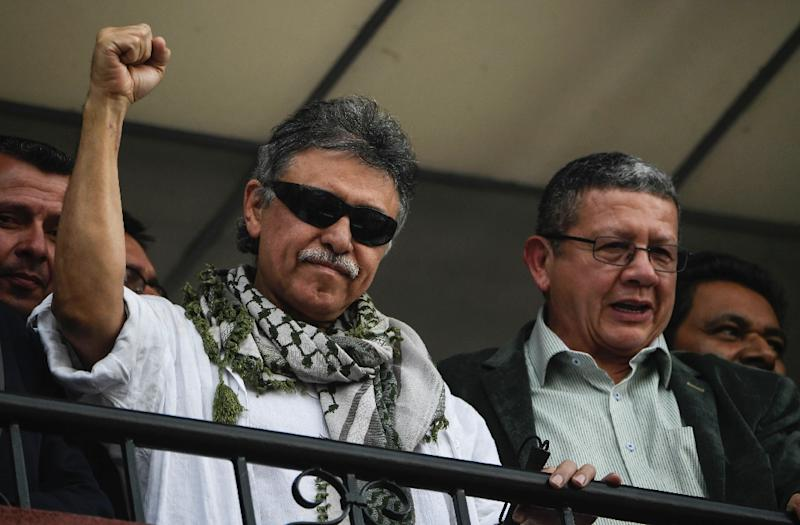 Former FARC commander Jesus Santrich (L) greets supporters after the Supreme Court ordered his release in Bogota, Colombia on May 30, 2019
