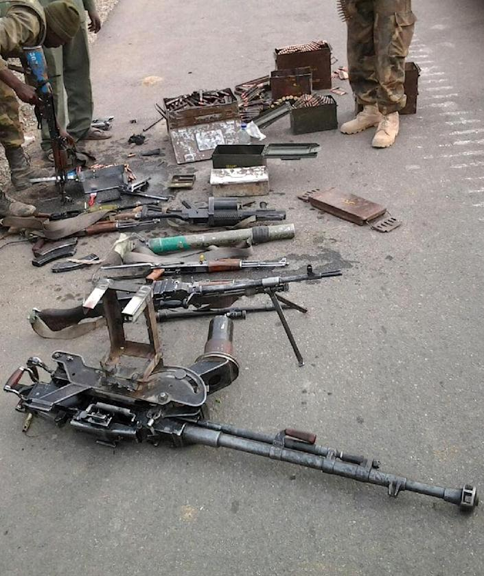 Handout photo by the Nigerian Army on February 27, 2015, shows arms and ammunition captured from Boko Haram fighters in Bara, Gulani district of Yobe State (AFP Photo/)