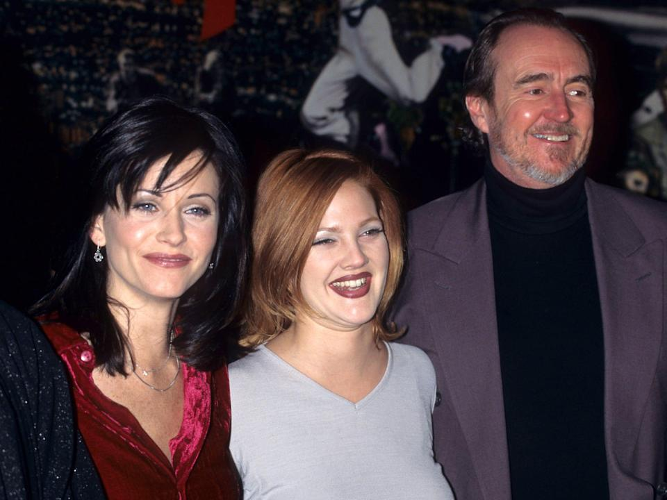 """Courteney Cox, Drew Barrymore and Wes Craven during """"""""Scream"""""""" Memorabilia presentation - December 12, 1996 in New York City, New York, United States."""