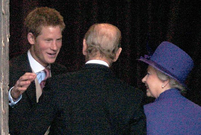 Prince Harry (left) greets his grandparents, the Queen and the Duke of Edinburgh at the wedding of Lady Tamara Grosvenor to Edward van Cutsem at Chester Cathedral. Prince William will act as usher at the lavish service attended by 650 guests, including the Queen and the Duke of Edinburgh. The wedding brings together two of Britain's wealthiest families. Lady Tamara Grosvenor, 24, is the eldest daughter of the Duke of Westminster, Britain's richest man, whose land holdings, including swathes of Mayfair and Belgravia, give him a personal fortune estimated at  4 billion.   (Photo by John Giles - PA Images/PA Images via Getty Images)
