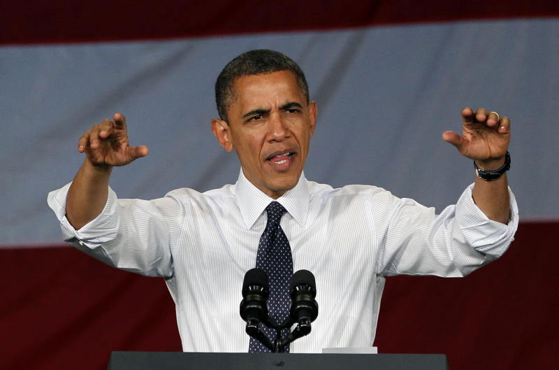 President Barack Obama motions to the crowd as he begins to speak at a fundraising event Thursday, May 10, 2012, in Seattle. (AP Photo/Elaine Thompson)