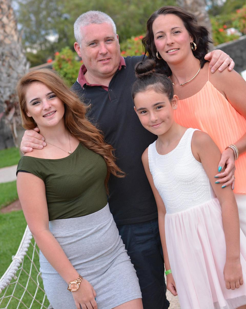 Brian Fernie with his partner and daughters (NHS Lanarkshire/PA)