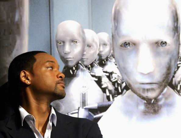 Will Smith casts a suspicious eye over his robot colleague... (Getty)