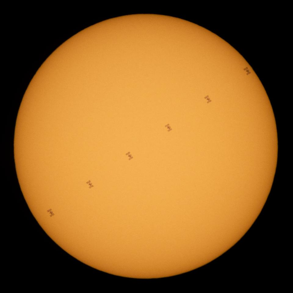 This composite image shows the International Space Station as it transits in front of the sun. Made up of six different frames taken from Fredericksburg, Virginia, this image shows the space station moving at approximately 5 miles per second on June 24, 2020. Five astronauts are currently onboard the space station, including Expedition 63 NASA astronauts Chris Cassidy, Douglas Hurley and Robert Behnken and Roscosmos cosmonauts Anatoly Ivanishin and Ivan Vagner.