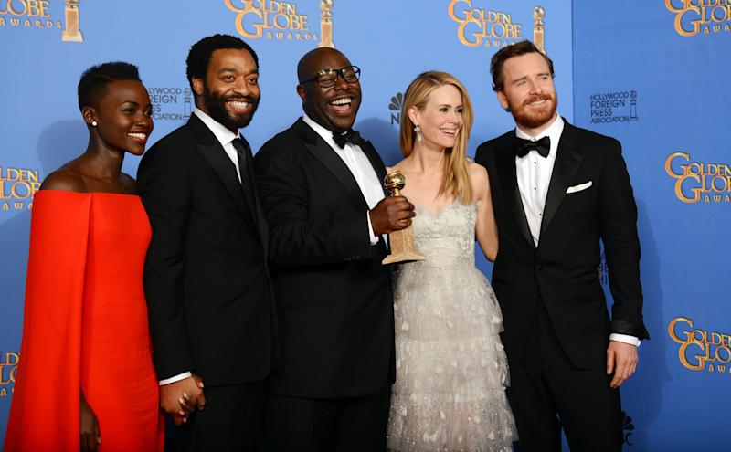 """From left, Lupita Nyong'o, Chiwetel Ejiofor, Steve McQueen, Sarah Paulson, and Michael Fassbender pose in the press room with the award for best motion picture - drama for """"12 Years a Slave"""" at the 71st annual Golden Globe Awards at the Beverly Hilton Hotel on Sunday, Jan. 12, 2014, in Beverly Hills, Calif. (Photo by Jordan Strauss/Invision/AP)"""