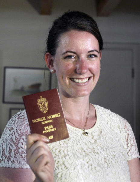Norwegian Marte Deborah Dalelv, 24, shows her passport at the Norwegian Seaman's Club in Dubai, United Arab Emirates, Monday, July 22, 2013. Dalelv at the center of a Dubai rape claim dispute said Sunday that officials have dropped her 16-month sentence for having sex outside marriage and she is free to leave the country. (AP Photo/Kamran Jebreili)