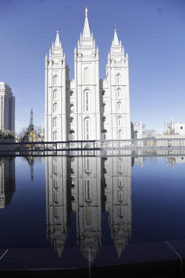 FILE - In this April 4, 2020 file photo, the Salt Lake Temple at Temple Square is shown during The Church of Jesus Christ of Latter-day Saints' twice-annual church conference in Salt Lake City. For the third consecutive time, The Church of Jesus Christ of Latter-day Saints will hold its signature conference this weekend without attendees in person as the faith continues to take precautions amid the pandemic. Members of the Utah-based faith will instead watch on TVs, computers and tablets from their homes around the world Saturday, April 3, 2021 to hear spiritual guidance from the religion's top leaders, who will be delivering the speeches in Salt Lake City. (AP Photo/Rick Bowmer)