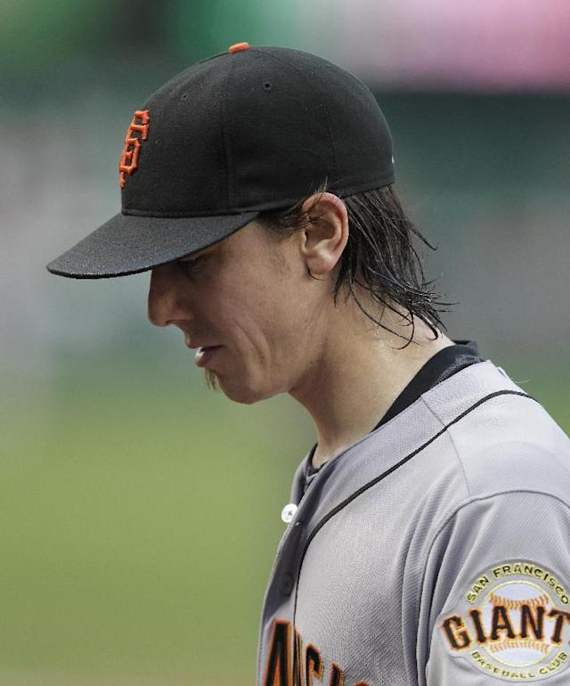 San Francisco Giants pitcher Tim Lincecum walks to the dugout after being taken out of a baseball game against the Washington Nationals during the third inning, Saturday, Aug. 23, 2014, in Washington. The Nationals won 6-2. (AP Photo/Luis M. Alvarez)