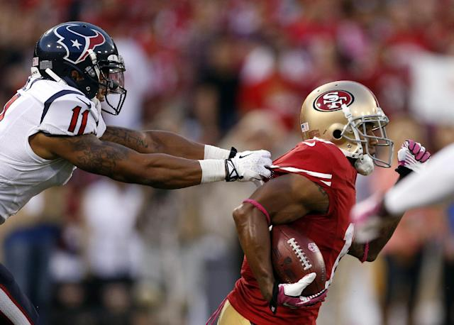 San Francisco 49ers wide receiver Kyle Williams, right, carries the ball as Houston Texans wide receiver DeVier Posey pulls his jersey in the first half of an NFL football game in San Francisco, Sunday, Oct. 6, 2013. (AP Photo/Beck Diefenbach)