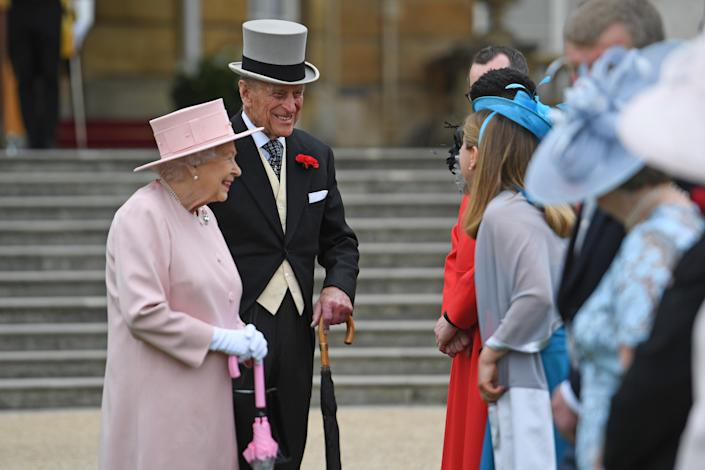 LONDON, ENGLAND - MAY 16: Queen Elizabeth II and Prince Phillip, Duke of Edinburgh talks to guests during a garden party at Buckingham Palace  on May 16, 2017 in London, England.  (Photo by Victoria Jones - WPA Pool /Getty Images)