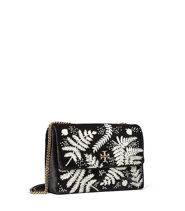 """<p><strong>Tory Burch</strong></p><p>toryburch.com</p><p><strong>$628.00</strong></p><p><a href=""""https://go.redirectingat.com?id=74968X1596630&url=https%3A%2F%2Fwww.toryburch.com%2Fkira-embroidered-velvet-convertible-shoulder-bag%2F77014.html&sref=https%3A%2F%2Fwww.townandcountrymag.com%2Fstyle%2Ffashion-trends%2Fg36755206%2Ftory-burchs-semi-annual-sale-june-2021%2F"""" rel=""""nofollow noopener"""" target=""""_blank"""" data-ylk=""""slk:Shop Now"""" class=""""link rapid-noclick-resp"""">Shop Now</a></p><p><strong><del>$628</del> $330 (47% off)</strong></p><p>Found: The perfect bag for your string of upcoming weddings. The luxe velvet exterior and sweet embroidery make this a suitable choice for black-tie events.</p>"""