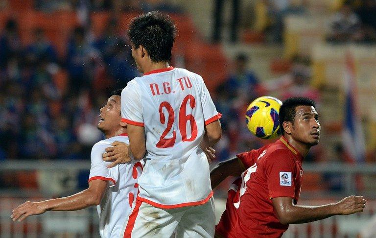 """Thailand's Sompong Soleb (R) battles with Vietnam's Nguyen Gia Tu during their AFF Suzuki Cup final group match in Bangkok on November 30. Thailand defeated Vietnam 3-1 to sweep into the semi-finals but the """"War Elephants"""" face a stern test against Malaysia"""