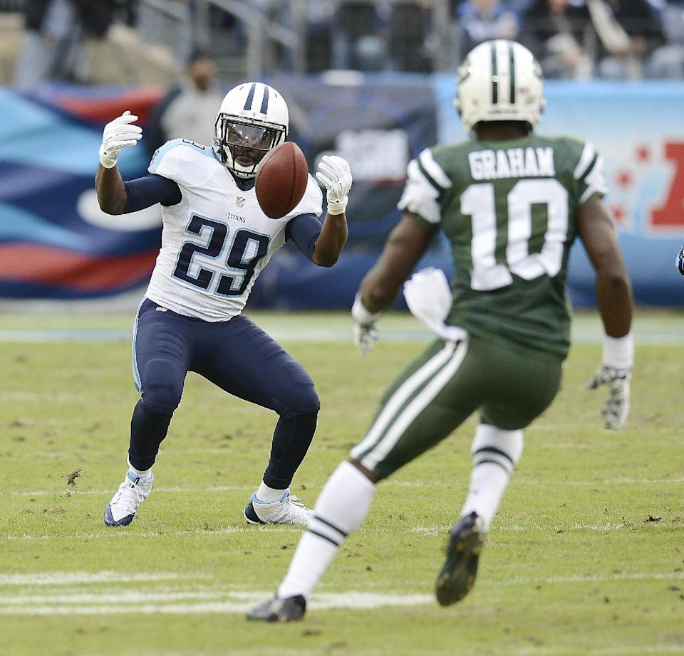 Tennessee Titans kick-returner Leon Washington (29) fumbles a free kick as New York Jets' T.J. Graham (10) closes in during the first half of an NFL football game Sunday, Dec. 14, 2014, in Nashville, Tenn. Graham recovered the ball on the play. (AP Photo/Mark Zaleski)