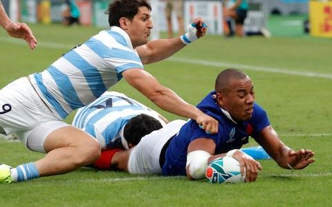 France's Gael Fickou scores a try as Argentina's Tomás Cubelli arrives late for the tackle during the Rugby World Cup Pool C game at Tokyo Stadium between France and Argentina in Tokyo, Japan, Saturday, Sept. 21, 2019 - Credit: AP