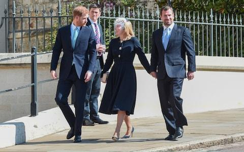 Prince Harry walks with Autumn and Peter Phillips - Credit: Getty