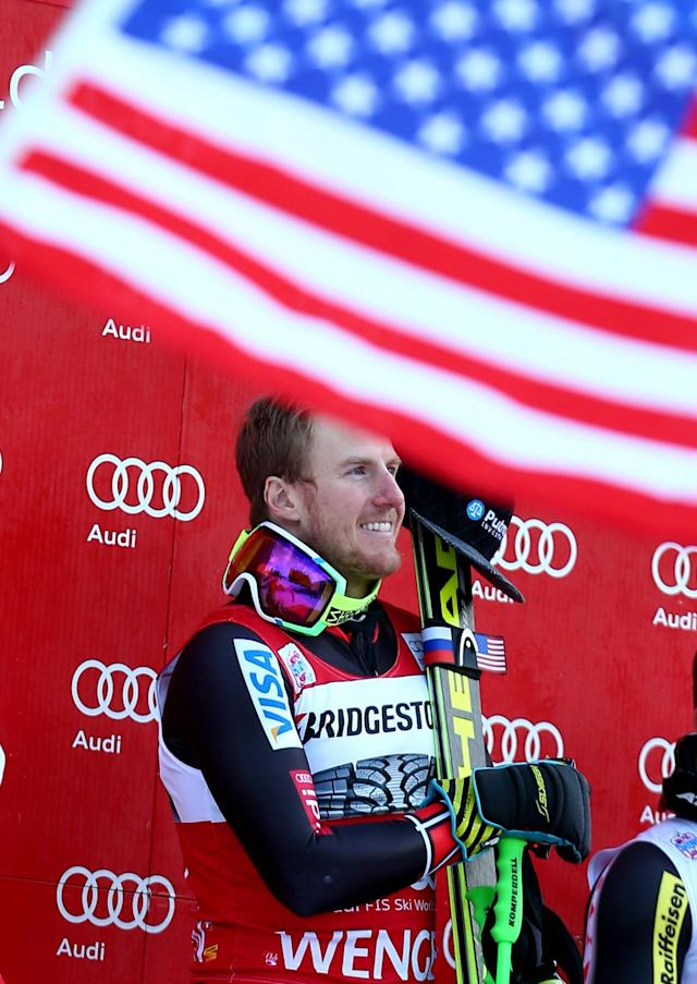Ted Ligety, of the United States, celebrates on the podium area after winning an alpine ski, men's World Cup super-combined, in Wengen, Switzerland, Friday, Jan. 17, 2014. (AP Photo/Giovanni Auletta)