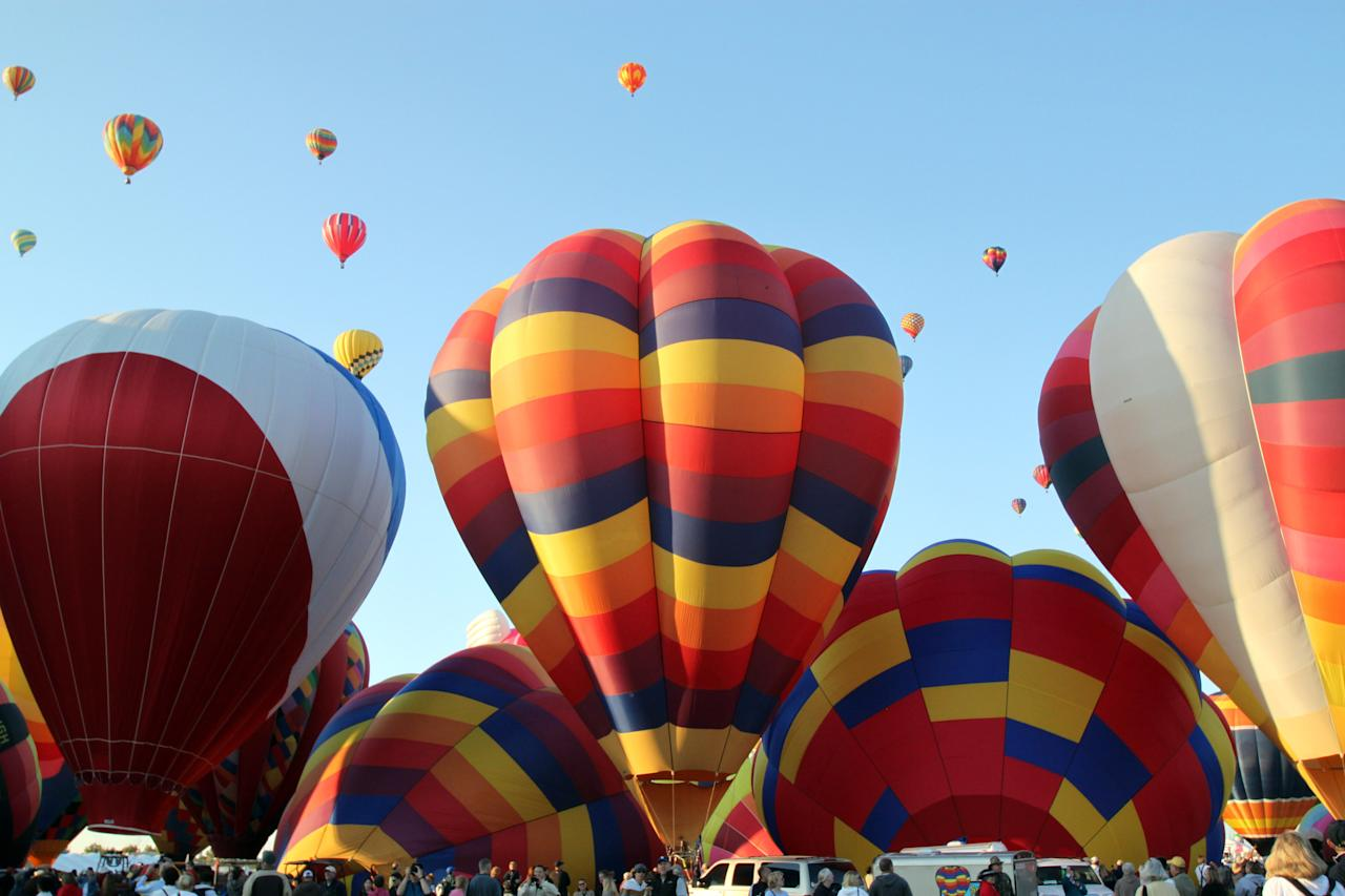 A hot air balloons inflate during the mass ascension at the Albuquerque International Balloon Fiesta in Albuquerque, N.M., on Saturday, Oct. 2, 2010. About 500 balloons were registered for the annual event.